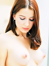 Erika FTV : Erika FTV slowly strips outdoors and teases us with her perky little breasts.