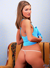 Tricia Nubiles : Tricia Nubiles takes her cute blue dress off and teases us in sexy white thongs.