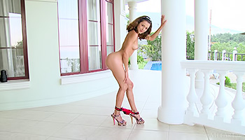 Fantastic beauty with a ripped body reveals it in high heels. Watch her play around on her balcony and show that tight ass of hers.