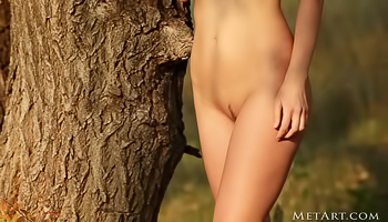 Sensational brunette is having passionate solo in the forest. She is taking off her beautiful dress and demonstrating her sensational young body.